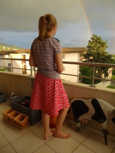 Becky in skirt on balcony
